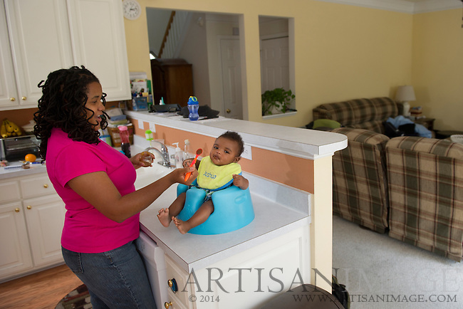 6-month-old Joshua Goins enjoys a Sunday afternoon at home with his Mom & Dad (Lanita & James) in Greensboro, NC on July 10, 2011. (Photography By Artisan Image/Chris English)