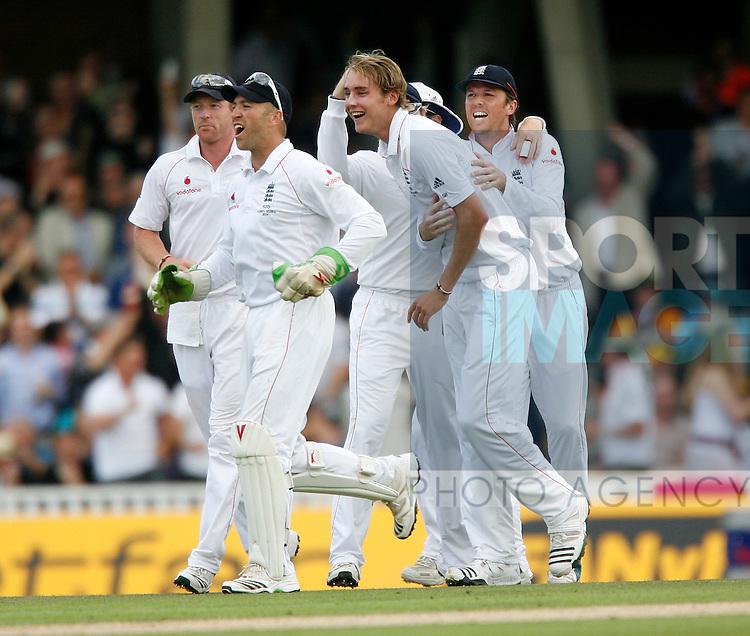 England's Stuart Broad celebrates taking the wicket of Australia's Michael Clarke for 3