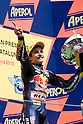 July 4, 2010 - Catalunya, Spain - Marc Marquez (Red Bull Ajo Motorsport) celebrates his victory on the podium after winning the 125cc race of the Catalunya Grand Prix on July 4, 2010. (Photo Andrew Northcott/Nippon News).