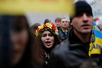 A woman shouts slogans against Russia government while Ukrainian immigrants take part in a protest against war in front of the Russia consulate in New York. March 2, 2014. Photo by Eduardo Munoz Alvarez/VIEWpress