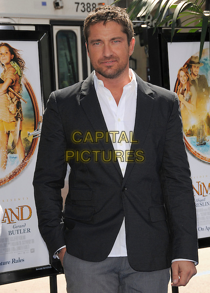 GERARD BUTLER .Attends Fox Walden's World Premiere of Nim's Island held at The Grauman's Chinese Theatre in Hollywood, California, USA, March 30th 2008                                                                     half length black suit jacket stubble facial hair hand in pocket.CAP/DVS.©Debbie VanStory/Capital Pictures