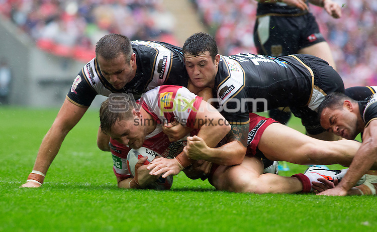PICTURE BY Gavin Rodgers/SWPIX.COM - Rugby League - 2013 Tetley's Challenge Cup Final - Hull FC v Wigan Warriors - Wembley Stadium, London, England - 24/08/2013 - Wigan's Gil Dudson is tackled bu Hull FC's Andy Lynch, Jay Pitts and Aaron Heremaia.