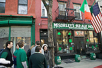 17 March 2006 - New York City, NY - People wait in line outside McSorley's pub in New York City, in the early morning, 17 March 2006. Every year McSorley's, one of New York's most famous Irish pubs, opens - and fills up immediately - at 8am on St Patrick's day. Some people start lining up as early as 6am.