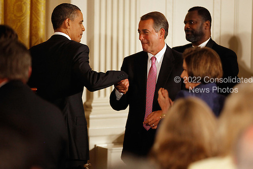 United States President Barack Obama (L) shakes hands with U.S.  Speaker of the House John Boehner (Republican of Ohio) before delivering remarks during a dinner with bipartisan Congressional leaders in the East Room of the White House, Monday, May 2, 2011 in Washington, DC. Obama and first lady Michelle Obama hosted a group of bipartisan committee chairmen and ranking members and their spouses for the dinner. .Credit: Chip Somodevilla / Pool via CNP