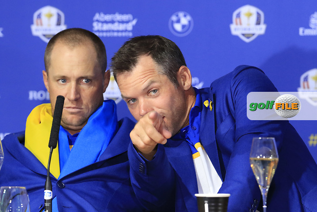 Alex Noran and Paul Casey (Team Europe) at the press conference after Europe win the Ryder Cup 17.5 to 10.5 at the end of Sunday's Singles Matches at the 2018 Ryder Cup 2018, Le Golf National, Ile-de-France, France. 30/09/2018.<br /> Picture Eoin Clarke / Golffile.ie<br /> <br /> All photo usage must carry mandatory copyright credit (© Golffile | Eoin Clarke)