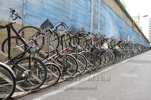 Mar 7, 2006; Tokyo, JPN; Ryogoku.School kids walk by a row of bicycles just outside the Ryogoku station...Photo credit: Darrell Miho