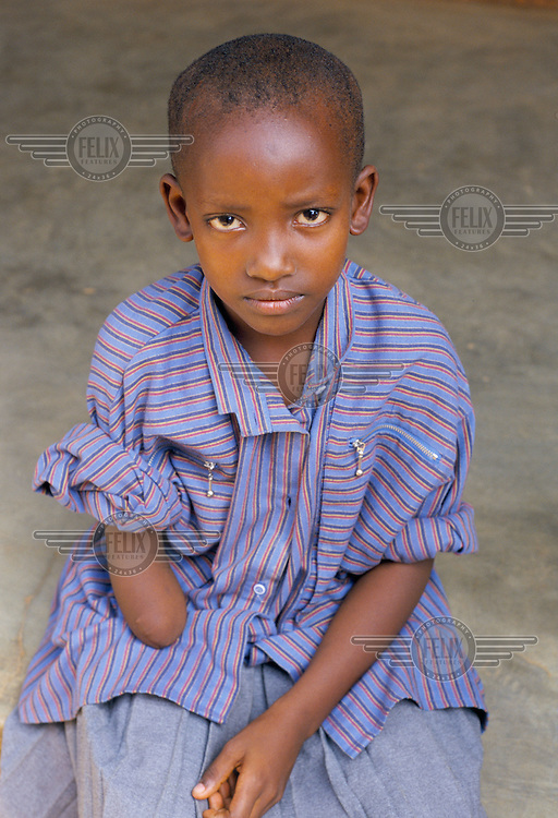 Nine year old Mushikiwabo was shot in the arm during the 1994 genocide. The arm later had to be amputated...
