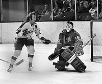 Seals Joey Johnston shoots on BlackHawk goalie Tony Esposito.  (1971 photo/Ron Riesterer)