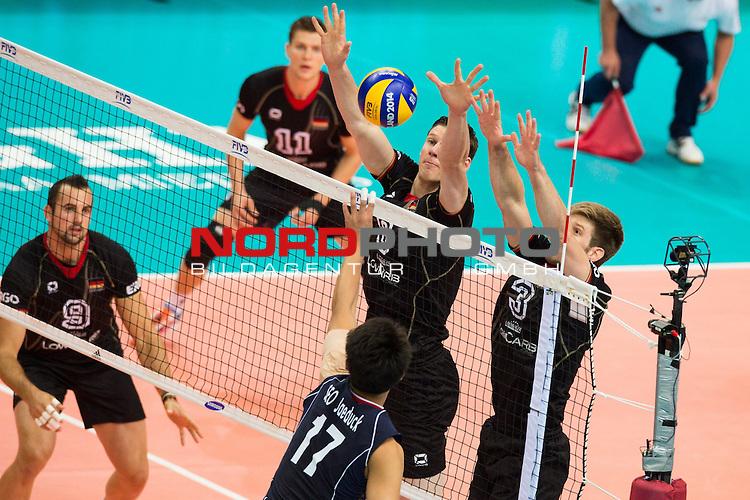 07.09.2014, Spodek, Kattowitz<br /> Volleyball, FIVB Volleyball Men`s World Championship 2014, Deutschland (GER) vs. Korea (KOR)<br /> <br /> Angriff Jae-Duck Seo (#17 KOR) - Block / Doppelblock Marcus B&ouml;hme / Boehme (#8 GER), Sebastian Schwarz (#3 GER)<br /> <br />   Foto &copy; nordphoto / Kurth