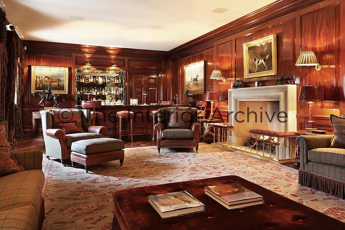 This panelled retreat with a bar could well be the setting of an Agatha Christie novel; with its cosy and luxurious seating and sporting paintings reflecting a distinctly early 20th century feel