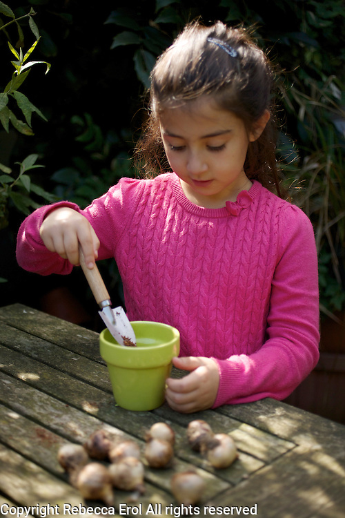 Young girl planting spring bulbs