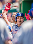 31 May 2014: Texas Rangers outfielder Shin-Soo Choo gets high-fives in the dugout after scoring on a Mitch Moreland single in the 6th inning against the Washington Nationals at Nationals Park in Washington, DC. The Nationals defeated the Rangers 10-2, notching a second win of their 3-game inter-league series. Mandatory Credit: Ed Wolfstein Photo *** RAW (NEF) Image File Available ***