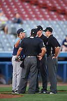 Trenton Thunder manager Bobby Mitchell (7) argues a call with umpires Jorge Teran, Ben Levin, and Ryan Wills during the second game of a doubleheader against the Hartford Yard Goats on June 1, 2016 at Sen. Thomas J. Dodd Memorial Stadium in Norwich, Connecticut.  Trenton defeated Hartford 2-1.  (Mike Janes/Four Seam Images)