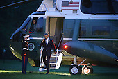 United States President Barack Obama salutes the Marine Guard as he exits Marine One as he returns to the White House October 3, 2014 in Washington, DC. Obama was in Princeton, Indiana, to tour Millennium Steel Service and have a conversation with workers to mark National Manufacturing Day. <br /> Credit: Alex Wong / Pool via CNP