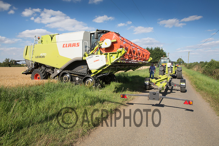 Attaching a header to a combine on a public road <br /> Picture Tim Scrivener 07850 303986<br /> &hellip;.covering agriculture in the UK&hellip;.