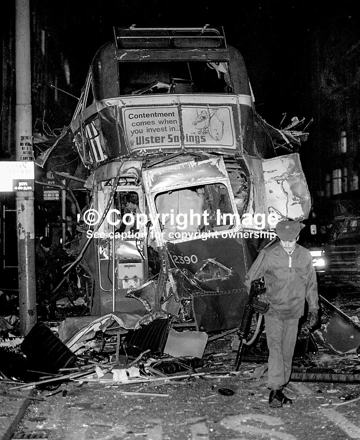 Badly-damaged double-decker bus which exploded outside the premises of C&amp;A in Donegal Place, Belfast, N Ireland, 14th December 1973. The vehicle was hijacked on the Glen Road, West Belfast, and the driver was forced to drive it into the city centre. Note the advertising slogan &ldquo;Contentment comes when you invest in Ulster Savings&rdquo;.  197312140766a<br /> <br /> Copyright Image from Victor Patterson, 54 Dorchester Park, <br /> Belfast, UK, BT9 6RJ<br /> <br /> t1: +44 28 9066 1296 (from Rep of Ireland 048 9066 1296)<br /> t2: +44 28 9002 2446 (from Rep of Ireland 048 9002 2446)<br /> m: +44 7802 353836<br /> <br /> e1: victorpatterson@me.com<br /> e2: victorpatterson@gmail.com<br /> <br /> www.victorpatterson.com<br /> <br /> Please see my Terms and Conditions of Use at VICTORPATTERSON.COM. It is IMPORTANT that you familiarise yourself with them.<br /> <br /> Images used on the Internet must be visibly watermarked i.e. &copy;VICTORPATTERSON.COM within the body of the image and copyright metadata must not be deleted. Images used on the Internet have a size restriction of 4kbs and are chargeable at the then current NUJ rates.<br /> <br /> This image is only available for the use of the download recipient i.e. television station, newspaper, magazine, book publisher, etc, and must not be passed on to any third party. It is also downloaded on condition that each and every usage is notified within 7 days to victorpatterson@me.com<br /> <br /> The right of Victor Patterson to be identified as the author is asserted in accordance with The Copyright Designs And Patents Act (1988).