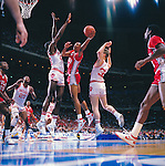 28 MAR 1987:  Indiana center Dean Garrett (22) and UNLV forward Jarvis Basnight (44) and Indiana forward Steve Eyl (32) during the NCAA Men's National Basketball Final Four semifinal game held in New Orleans, LA, at the Louisiana Superdome. Indiana defeated UNLV 97-93 to meet Syracuse for the championship. Rich Clarkson/NCAA Photos.SI CD 0024-21