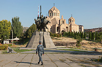 Armenia. Yerevan. A policeman walks in front of the Saint Gregory the Illuminator Cathedral and the equestrian statue of Andranik. The Saint Gregory the Illuminator Cathedral, also known as the Yerevan Cathedral is currently the largest cathedral of the Armenian Apostolic Church in the world. The Armenian Apostolic Church is the national church of the Armenian people. Part of Oriental Orthodoxy, it is one of the most ancient Christian communities. Andranik Ozanian, commonly known as Andranik (25 February 1865 – 31 August 1927) was an Armenian military commander and statesman, the best known fedayi and a key figure of the Armenian national liberation movement. From the late 19th century to the early 20th century, he was one of the main Armenian leaders of military efforts for the independence of Armenia. Yerevan, sometimes spelled Erevan, is the capital and largest city of Armenia. 10.10.2019 © 2019 Didier Ruef