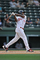 First baseman Josh Ockimey (18) of the Greenville Drive bats in a game against the Charleston RiverDogs on Tuesday, May 17, 2016, at Fluor Field at the West End in Greenville, South Carolina. Greenville won, 4-2. (Tom Priddy/Four Seam Images)