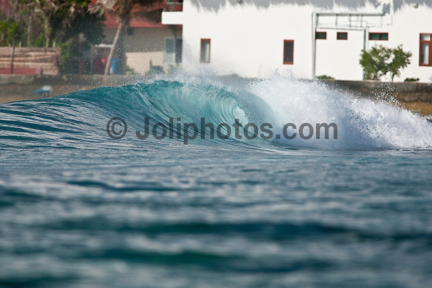 An empty wave breaks over a shallow coral reef in the South Male Atolls, Maldives (Tuesday, June 16th, 2009). Photo: joliphotos.com