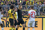 06.10.2018, Signal Iduna Park, Dortmund, GER, DFL, BL, Borussia Dortmund vs FC Augsburg, DFL regulations prohibit any use of photographs as image sequences and/or quasi-video<br /> <br /> im Bild Markus Schmidt (SR) (Schiedsrichter, referee), gibt Alfreo Finnbogason (#27, FC Augsburg) Gelb / gelbe Karte <br /> <br /> Foto &copy; nph/Horst Mauelshagen