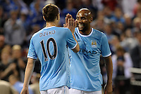Maicon celebrates Edin Dzeko (10) goal..Manchester City defeated Chelsea 4-3 in an international friendly at Busch Stadium, St Louis, Missouri.