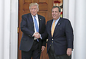New Jersey Governor Chris Christie (L) shakes hands with United States President-elect Donald Trump at the clubhouse of Trump International Golf Club, in Bedminster Township, New Jersey, USA, 20 November 2016.<br /> Credit: Peter Foley / Pool via CNP