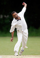 A Mohammed bowls for Wembley during the Middlesex County Cricket League Division Three game between Hornsey and Wembley at Tivoli Road, Crouch End, London on Sat May 29, 2010