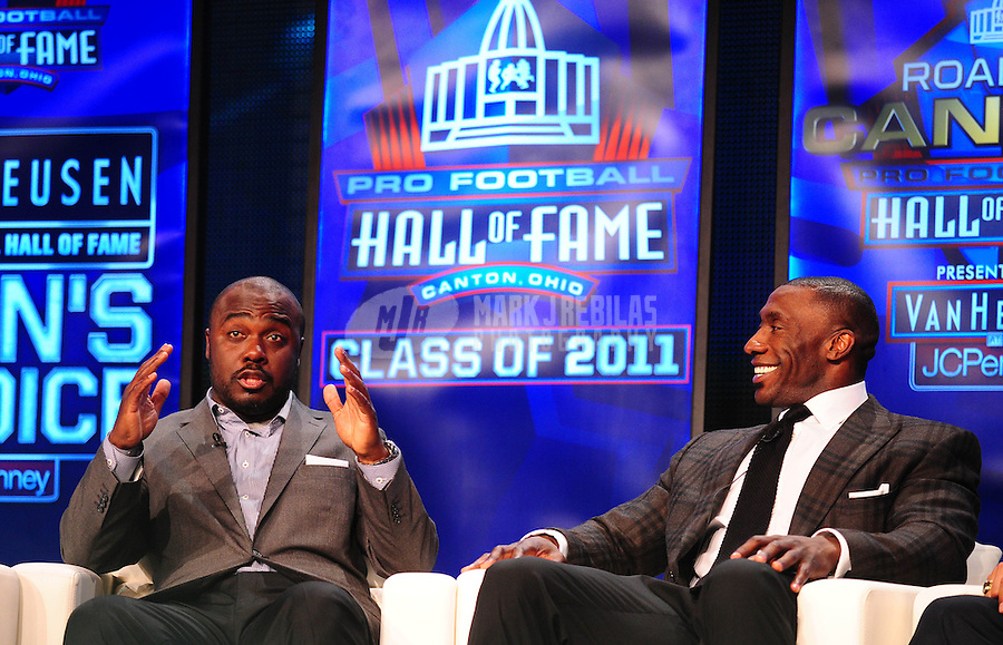 February 5, 2011; Dallas, TX, USA; Marshall Faulk (left) talks as Shannon Sharpe (right) looks on during a press conference after being named into the NFL Hall of Fame class of 2011 at the Super Bowl XLV media center. Mandatory Credit: Mark J. Rebilas-