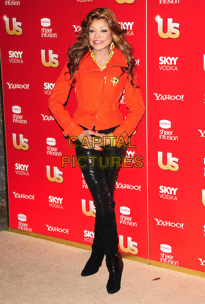 LA TOYA JACKSON.US Weekly's Hot Hollywood Party 2009 held at Voyeur, West Hollywood, California, USA. .November 18th, 2009.full length orange red biker jacket LaToya black sequined sequins trousers leggings boots gold brooch bracelets .CAP/RKE/DVS.©DVS/RockinExposures/Capital Pictures.