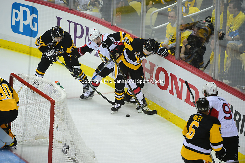 May 25, 2017: Pittsburgh Penguins defenseman Olli Maatta (3) shield the puck from Ottawa Senators center Jean-Gabriel Pageau (44)  during game seven of the National Hockey League Eastern Conference Finals between the Ottawa Senators and the Pittsburgh Penguins, held at PPG Paints Arena, in Pittsburgh, PA. The Pittsburgh Penguins defeat the Ottawa Senators 3-2 in double overtime to win the NHL Eastern Conference Championship and advance to face the Nashville Predators in the Stanley Cup Finals.  Eric Canha/CSM