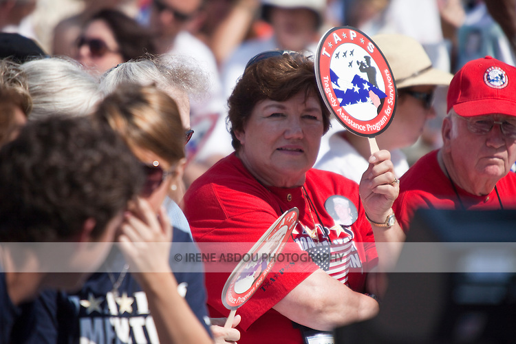 A woman displays a TAPS (Tragedy Assistance Program for Survivors) sign at the 2010 Memorial Day event at the Arlington National Cemetery in Virginia.