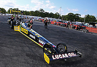 Aug 15, 2014; Brainerd, MN, USA; Crew members push NHRA top fuel dragster driver Richie Crampton forward in the staging lanes during qualifying for the Lucas Oil Nationals at Brainerd International Raceway. Mandatory Credit: Mark J. Rebilas-