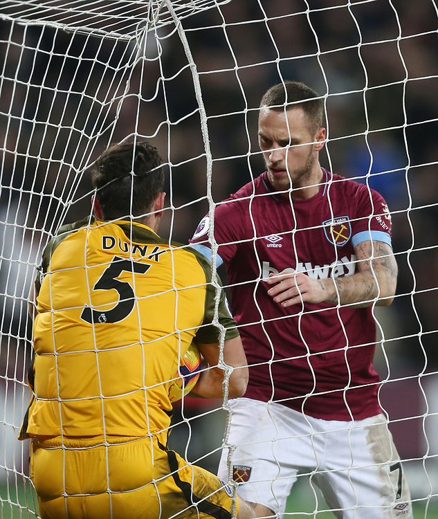 West Ham United's Marko Arnautovic pushes Brighton & Hove Albion's Lewis Dunk into the net trying to retrieve the ball after scoring the first of his two goals <br /> <br /> Photographer Rob Newell/CameraSport<br /> <br /> The Premier League - West Ham United v Brighton and Hove Albion - Wednesday 2nd January 2019 - London Stadium - London<br /> <br /> World Copyright © 2019 CameraSport. All rights reserved. 43 Linden Ave. Countesthorpe. Leicester. England. LE8 5PG - Tel: +44 (0) 116 277 4147 - admin@camerasport.com - www.camerasport.com
