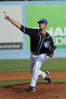 Asheville Tourists pitcher Josh Slaats #33 delivers a during a game against the Rome Braves at McCormick Field on August 20, 2011 in Asheville, North Carolina. Rome won the game 10-9.   (Tony Farlow/Four Seam Images)