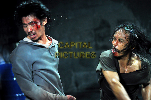 Doni Alamsyah & Yayan Ruhian .in The Raid: Redemption (Serbuan maut).*Filmstill - Editorial Use Only*.CAP/FB.Supplied by Capital Pictures.