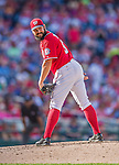 6 September 2014: Washington Nationals starting pitcher Tanner Roark glances back to first during game action against the Philadelphia Phillies at Nationals Park in Washington, DC. The Nationals fell to the Phillies 3-1 in the second game of their 3-game series. Mandatory Credit: Ed Wolfstein Photo *** RAW (NEF) Image File Available ***