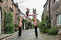 Members of Australian circus troupe, Circa, limber up in Circus Lane, Stockbridge, ahead of their run at the Underbelly, as part of the Edinburgh Festival Fringe. L to r: Daniel O'Brien, Lauren Herley, Jarred Dewey.