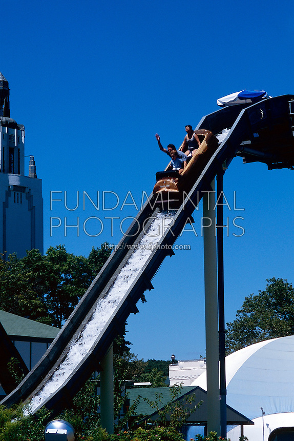 AMUSEMENT PARK RIDES<br /> Log Flume<br /> Water acts as a lubricant reducing friction between the log and the slide.