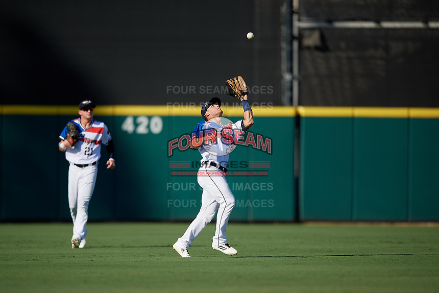 Lakeland Flying Tigers outfielder Brady Policelli (7) catches a fly ball as Brock Deatherage (left) backs up the play during a Florida State League game against the Fort Myers Miracle on August 3, 2019 at Publix Field at Joker Marchant Stadium in Lakeland, Florida.  Lakeland defeated Fort Myers 4-3.  (Mike Janes/Four Seam Images)