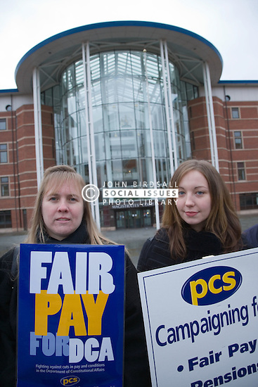 Women union members demonstrating during strike action outside the entrance to the Nottingham Magistrate's Court building,