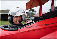 BNPS.co.uk (01202 558833)<br /> Pic: RobHenry/BNPS<br /> <br /> Chocks away....Peter prepares for take-off.<br /> <br /> The feared Fokker Dreidecker of the Red Baron has finally flown over Britian skies - after British based German doctor 'Baron' Peter von Brueggemann spent 9 years building a replica in his garage.<br /> <br /> The German GP based in Norfolk has spent 9 years building a Fokker triplane as a tribute to infamous WW1 Ace Manfred von Ricthofen, who terrorised the skies over the Western front during the first war.<br /> <br /> Dr Peter Brueggemann, 53, fufilled his childhood dream and emulated the notorious German fighter Ace when his hand built Dreidecker finally took off this week.<br /> <br /> Dr Brueggemann has even acquired the title Baron from the independent territory of Sealand so he can take to the skies as Baron Peter von Brueggemann in homage to his idol.<br /> <br /> The GP at the Holt Medical Practice in Norfolk finally reached for the sky at Felthorpe airfield near Norwich this week in front of nervous friends and family after thousands of hours spent crafting the aircraft.<br /> <br /> The father-of-two, who has lived in England with wife Sue for 20 years, has been taking flying lessons since his project began.