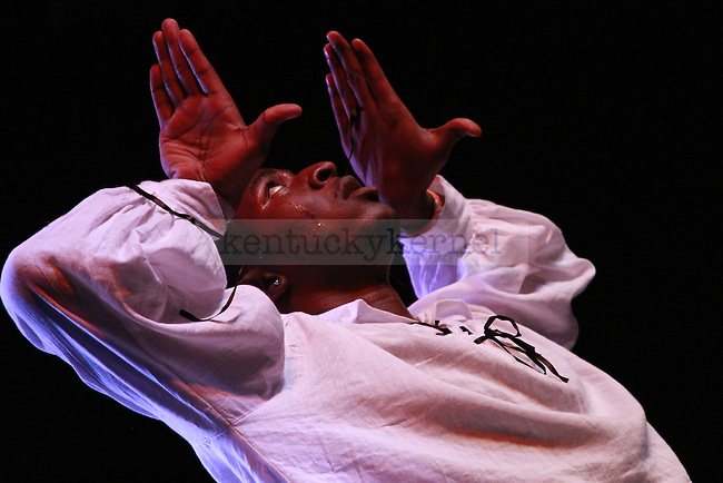 "James Harris, a member of Omega Psi Phi Fraternity, Inc. throws up a ""hook"" during the step show at the University of Kentucky on Friday, Oct. 21, 2011. Photo by Alex Lovan 
