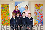 Local Artist from Lixnaw Jean McNamara has donated two of his paintings to Kilflynn School. Pictured Darragh Quilter, Clodagh Bailey,Cahill O'Connell and Katie Buckley with Artist  Jean McNamara and Principal Mary Carroll