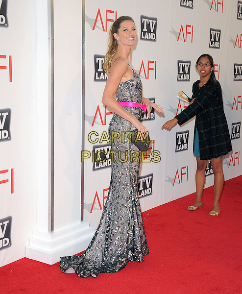 Gisele Bundchen.at TV Land's 2011 AFI Lifetime AChievement Award Honoring Morgan Freeman held at Sony Picture Studios in Culver City, California, USA, .June 9th 2011..full length dress pink belt  long maxi  silver beaded grey gray straps bow clutch bag sequined sequin  back rear behind .CAP/RKE/DVS.©DVS/RockinExposures/Capital Pictures.