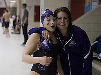 NWA Democrat-Gazette/CHARLIE KAIJO Fayetteville's Audrey McKinnon and Lizzie Stevens (from left) embrace during a swim meet, Saturday, February 9, 2019 at the University of Arkansas HYPER pool in Fayetteville.