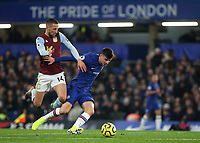 Mason Mount of Chelsea tries to shake off a challenge from Aston Villa's Conor Hourihane during Chelsea vs Aston Villa, Premier League Football at Stamford Bridge on 4th December 2019