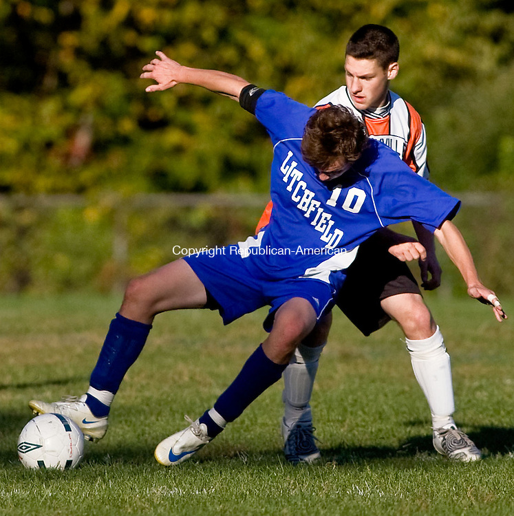 TERRYVILLE, CT - 07 OCTOBER 2008 -100708JT09--<br /> Litchfield's Adam Claire, left, falls in front of Terryville's Ben Draper just before a whistle is blown against Terryville during Tuesday's game in Terryville. The game was tied, 3-3.<br /> Josalee Thrift / Republican-American