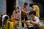 Women make paper flowers in Zhanshan monastery located between the new and old part of Qingdao. Laoshan is the center and origin of taoism.
