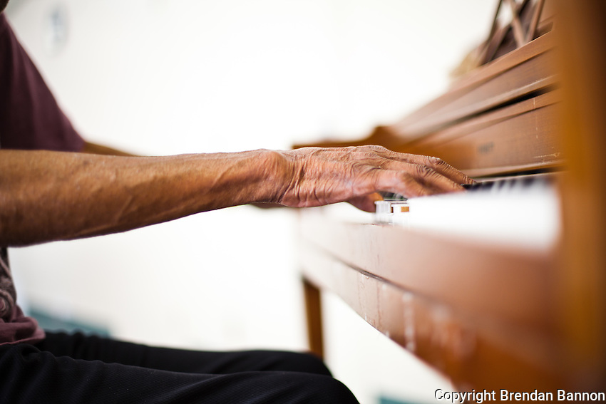 85 year old pianist Boyd Lee Dunlop practicing on an out of tune Everett piano in the nursing home where he resides. Buffalo, NY 2010.